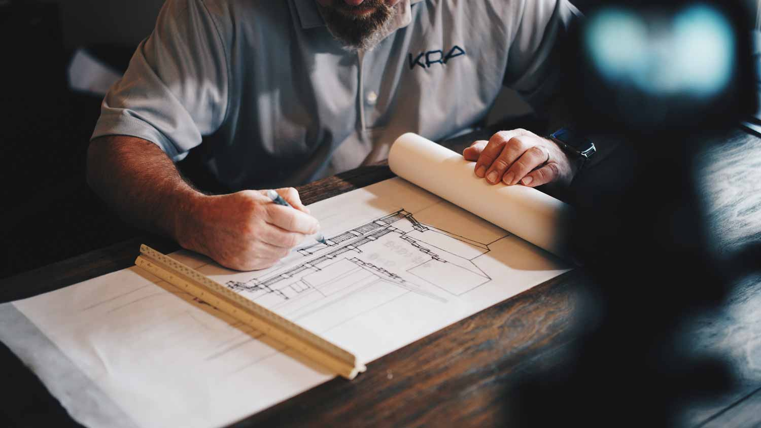 architect drafting a home renovation sketch