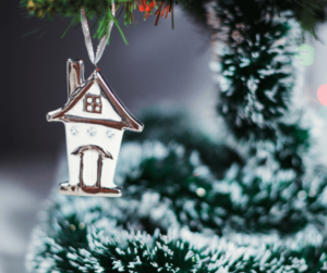 christmas tree with a decoration of a small house